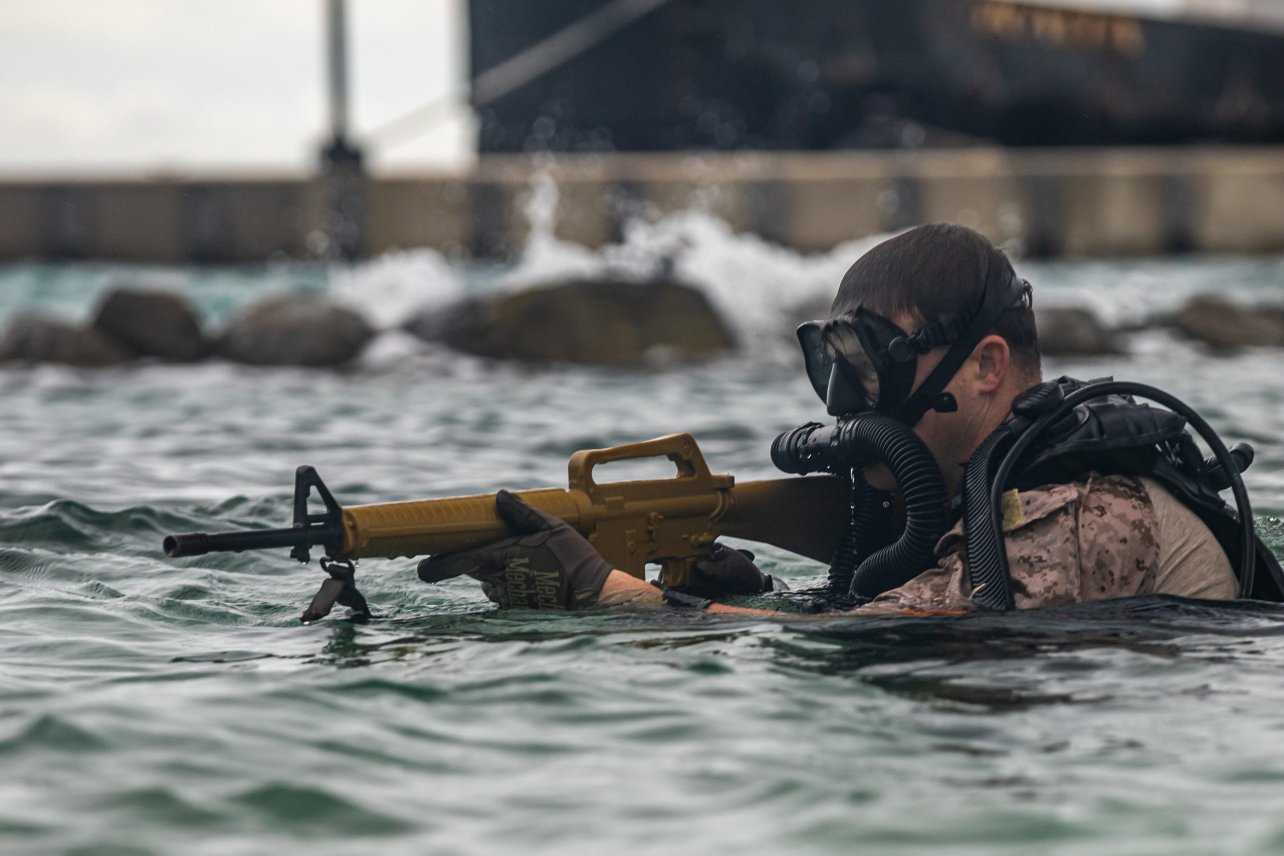 SAVANETA, Aruba (Nov. 13, 2020) U.S. Marine Corps Staff Sgt. Joseph Deblaay, a reconnaissance Marine with C Company, 2nd Reconnaissance Battalion (Recon Bn.), 2nd Marine Division (MARDIV), ascends from the water while participating in a dive training with Dutch marines with the 32nd Raiding Squadron near Netherlands Marine Barracks Savaneta, Aruba, Nov. 13, 2020. These dive skills are critical when fighting in littoral and coastal regions. 2nd Recon Bn's mastery of these skills is paramount to integrate effectively with their naval counterparts to win the next major conflict. Being able to learn from the Dutch marines in their primary area of operation helps 2nd Recon Bn. build a faster, more mobile and more lethal force when operating in diverse locations. (U.S. Marine Corps photo by Lance Cpl. Brian Bolin Jr.)